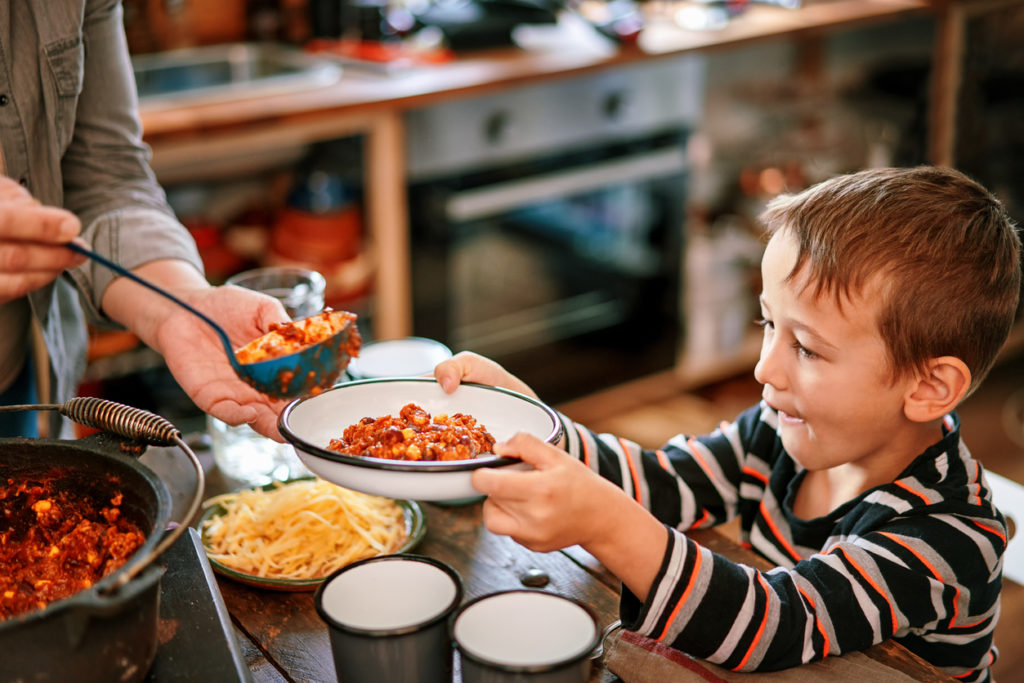 Young Family Eating Chili