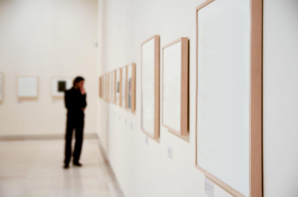 Man admiring art in an art gallery
