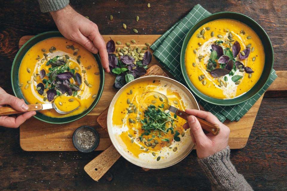 Men eating Vegan Creamy Roasted Pumpkin Soup